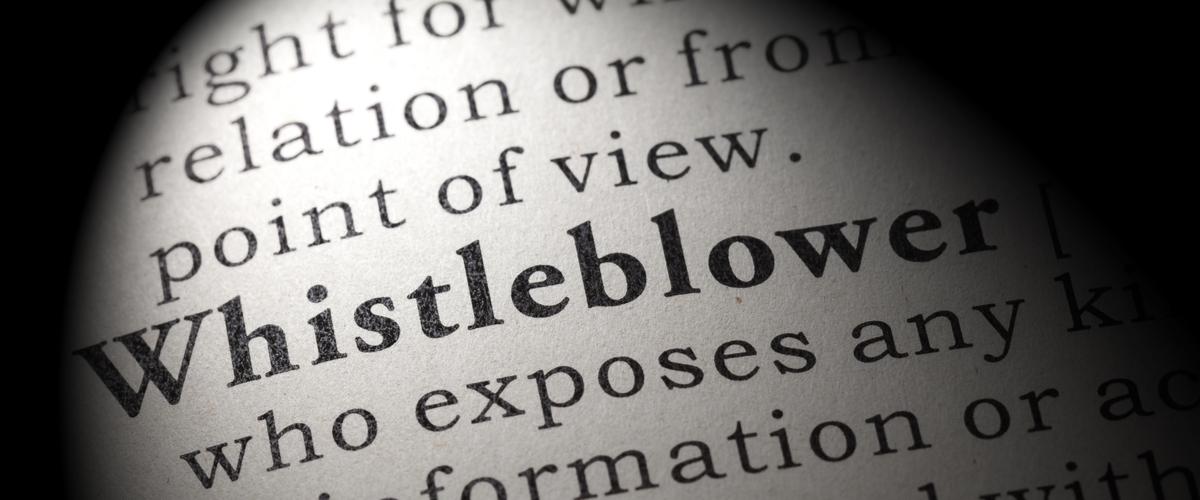 Het woord Whistleblower in een boek