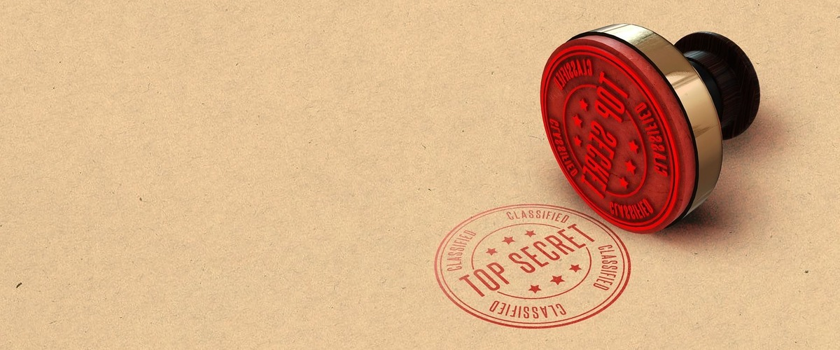 "Round stamp delivers the words ""top secret"" in red"