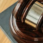 A gavel on a wooden table
